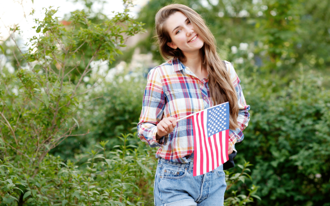 Woman holding a US flag on a stick