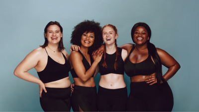 Four women of various body types in workout apparel