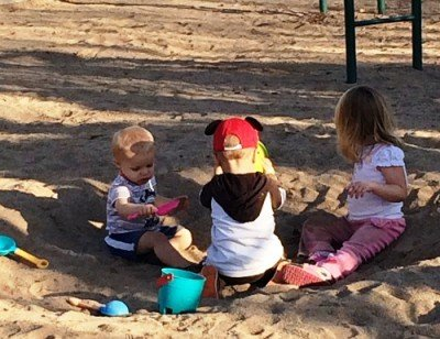 empowering kids at park sandbox