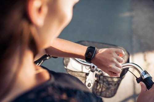 woman on bike with watch