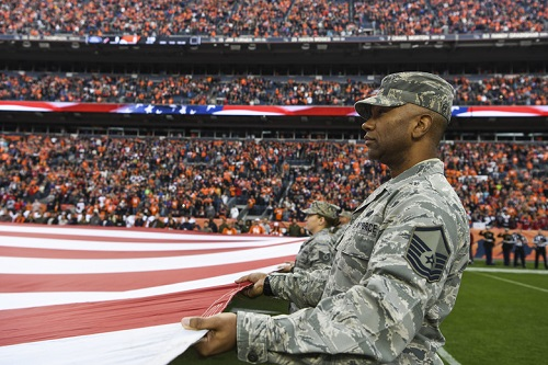 9d795615803 If you're be watching football this Sunday, or any time throughout November,  a few things may have looked a bit different. More servicemembers on the ...