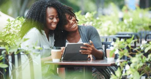 Two black women enjoying coffee together