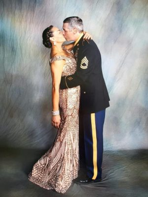 Military couple kissing at a Military ball