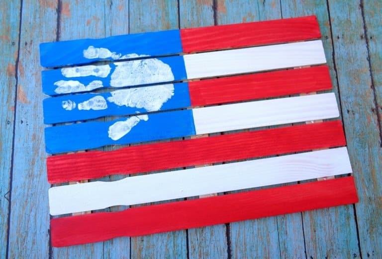 Kids handprint on an American flag painting