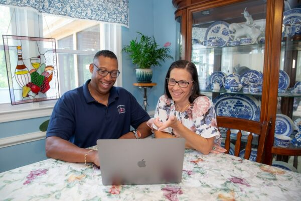 Military Couple looking at a laptop smiling